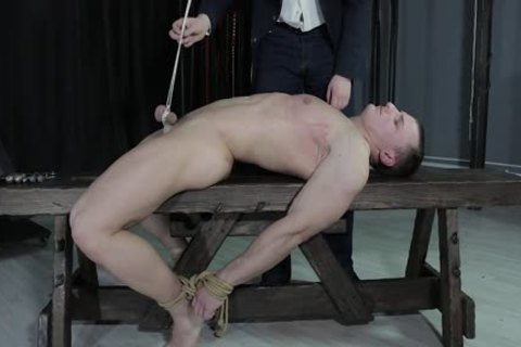 dirty lad tied Down, Balls Strung Up And Spanked
